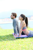 Couple doing stretching on seaside Royalty Free Stock Photography