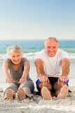 Couple doing their streches at the beach Stock Photography