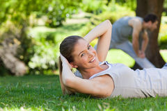 Couple doing their stretches in the park Stock Photo