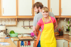 Couple doing the washing up in kitchen Stock Image