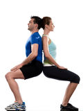 Couple doing workout back to back Royalty Free Stock Photography