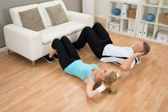 Couple doing workout Royalty Free Stock Photos