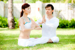 Couple Doing Yoga Stock Photo