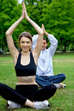 Couple doing yoga Royalty Free Stock Photos