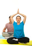 Couple doing yoga Stock Images