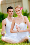 Couple Doing Yoga Royalty Free Stock Image