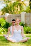 Couple Doing Yoga Stock Photo