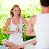 Couple doing yoga Royalty Free Stock Photography
