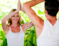 Couple doing yoga stock image