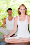 Couple doing yoga Royalty Free Stock Images