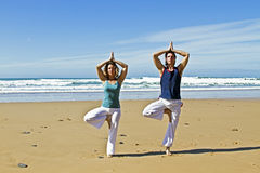 Couple doing yoga excersises Stock Images