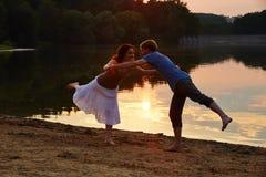 Couple doing yoga exercise on beach Royalty Free Stock Photos