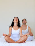 Couple doing yoga at home Royalty Free Stock Images