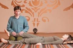 Couple doing yoga. Massage Stock Photography