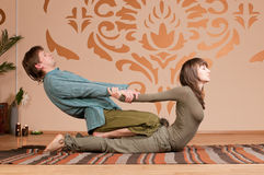 Couple doing yoga. Massage Stock Photos