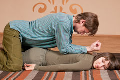Couple doing yoga. Massage Royalty Free Stock Photos
