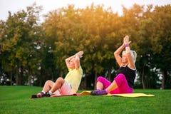 Couple doing yoga outdoor. Stock Image
