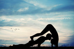 Couple doing yoga pose Royalty Free Stock Photography