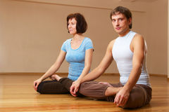Couple doing yoga practice Stock Image
