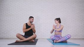 Couple doing yoga in studio stock video footage