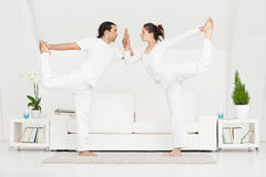 Couple Doing Yoga Royalty Free Stock Photo