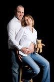 Couple with doll Stock Images