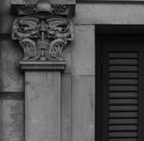 A couple of dragons. Shot in black and white. Placed on the facade of this historic building , sculpture on the capital representing a pair of dragons. Set in Stock Photo