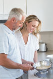 Couple draining spaghetti in colander Stock Photography