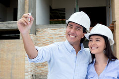 Couple drawing a house sketch Royalty Free Stock Photos