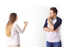 Couple drawing on a white wall. Happy couple drawing on a white wall planning future Royalty Free Stock Photo