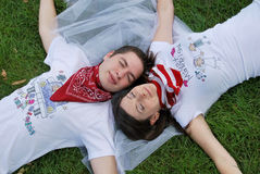 Couple dreaming on the grass Royalty Free Stock Photo