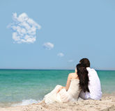 Couple dreaming about house on beach Royalty Free Stock Image