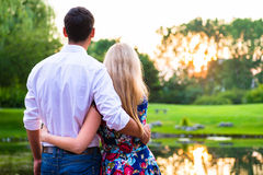 Couple dreaming their life together looking in sunset Stock Photo