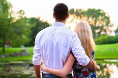 Couple dreaming their life together looking in sunset Royalty Free Stock Image