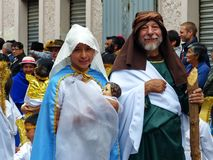 Couple dressed as Joseph and Mary with baby Jesus doll. Cuenca, ecuador royalty free stock images