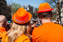 Couple dressed in orange - Koninginnedag 2012. Koninginnedag or Queen's Day is a national holiday in the Netherlands, the Netherlands Antilles, and Aruba on 30 Royalty Free Stock Photo