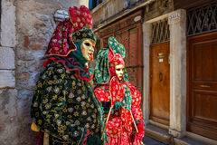 Couple dressed in traditional carnival costumes in Venice. Royalty Free Stock Photo