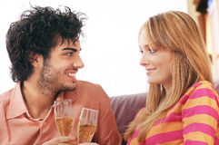 Couple and drink. Young couple smiling and drinking together Stock Image