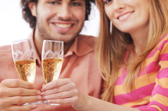 Couple and drink. Young couple smiling and drinking together Royalty Free Stock Photo