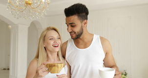 Couple drink coffee morning near window mix race man woman smile stock video footage