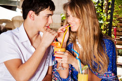 Couple drink juice outdoor Stock Image