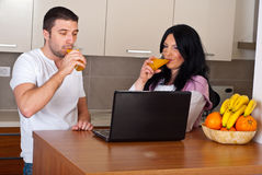 Couple drink juice and using laptop Stock Image