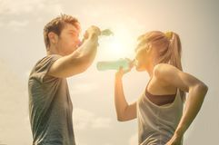 Couple drink water after running Royalty Free Stock Images