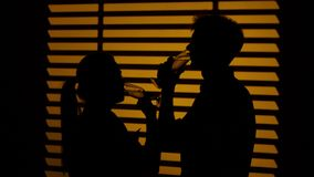 Couple drink wine. Silhouette. Close up stock video footage