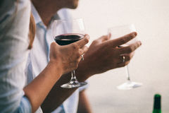 Couple drink wine at sunset beach stock photography
