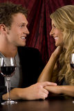 Couple drinking. Attractive couple drinking wine together Stock Photos