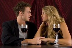 Couple drinking. Attractive couple drinking wine together Stock Photo