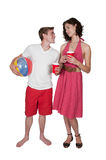 Couple drinking at the beach Stock Photo