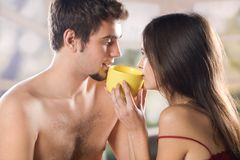 Couple drinking on the bed in bedroom Royalty Free Stock Photos