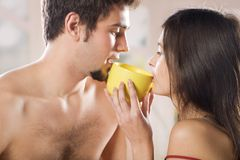 Couple drinking on the bed in bedroom Royalty Free Stock Photo